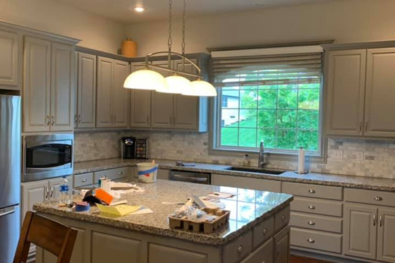 home kitchen with island in the center